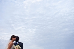 bride and groom sky