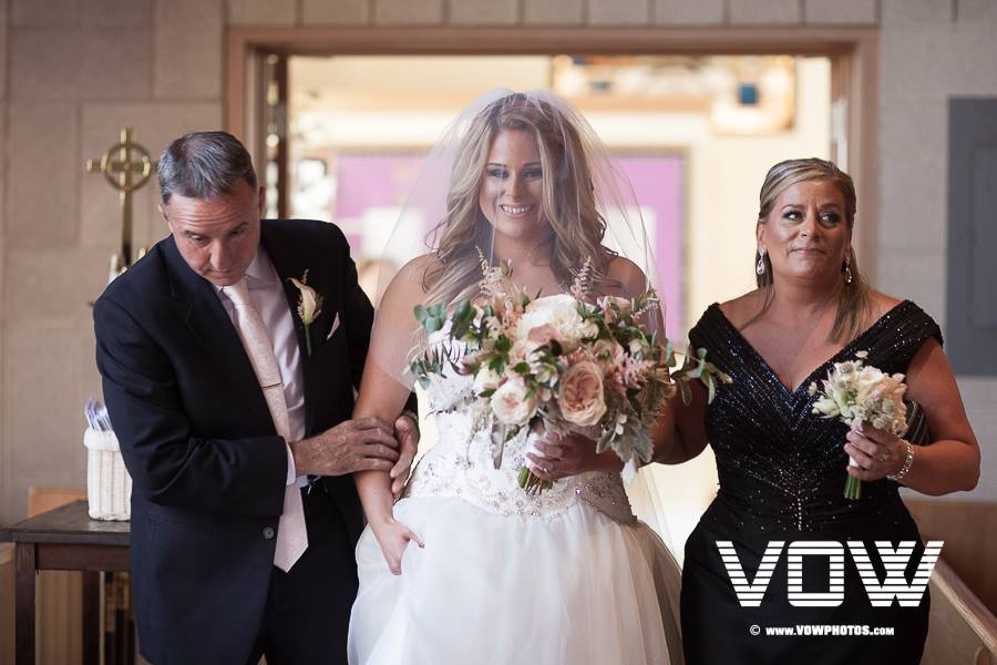 parents-walking-bride-down-the-aisle